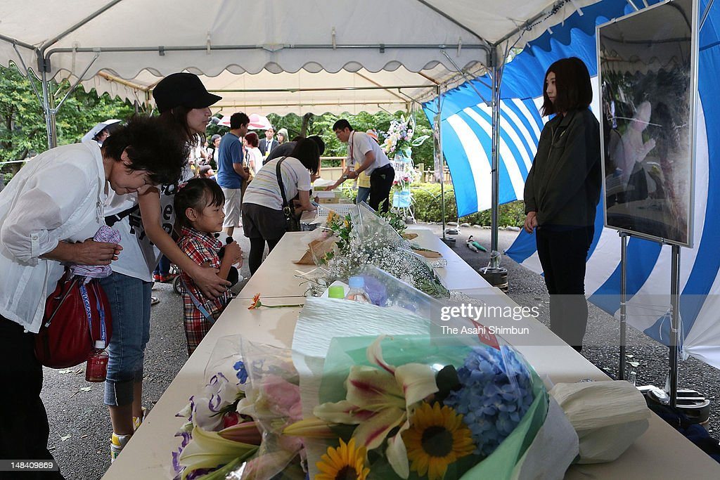 Flower bunches are placed on the altar at Ueno Zoo on July 12, 2012 in Tokyo, Japan. A newborn giant panda that captivated and delighted a nation, the first to be born in 24 years at Tokyo's Ueno Zoological Gardens, died of pneumonia on the morning of July 11, zoo officials said.
