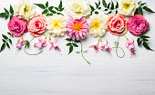 Festive flower composition on the white wooden background. Overhead view