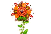 Flower concept made with healthy fresh tomatoes, vegetables, herbs and spices isolated on white background. top view