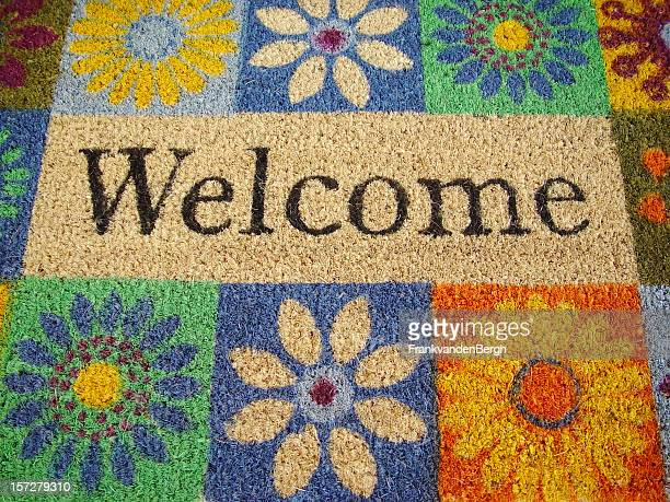 Flower decorated doormat with welcome sign