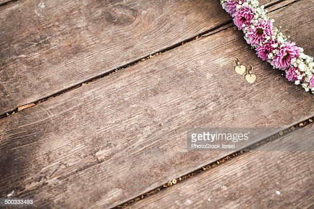 Flower frame on wooden background