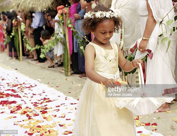 Flower girl in aisle