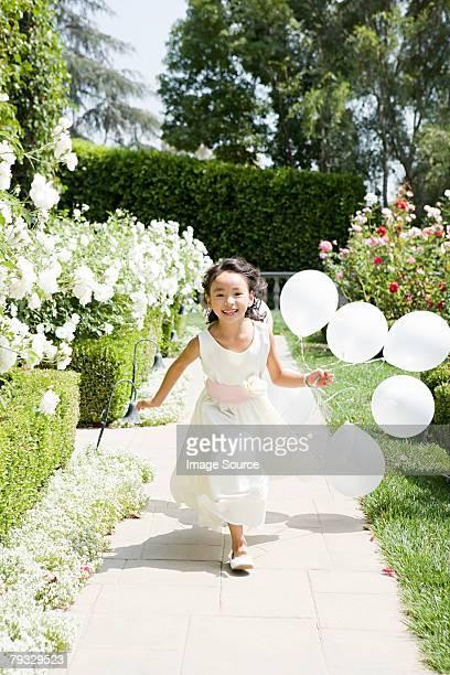 Fleur fille avec des ballons