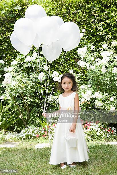 Flower girl with balloons