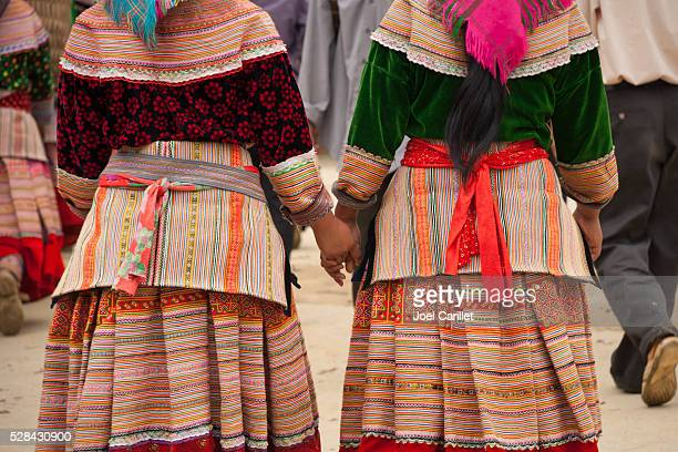 Flower Hmong women holding hands