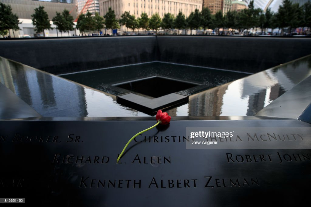 A flower is left at the North pool during a commemoration ceremony for the victims of the September 11 terrorist attacks at the National September 11 Memorial, September 11, 2017 in New York City. In New York City and throughout the United States, the country is marking the 16th anniversary of the September 11 terrorist attacks.