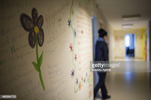 A flower painted on a wall is seen at a women's shelter on International Women's Day in Ankara Turkey on March 8 2015 Women staying in a women's...