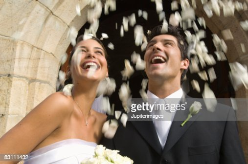 Flower petals over bride and groom : Stock Photo
