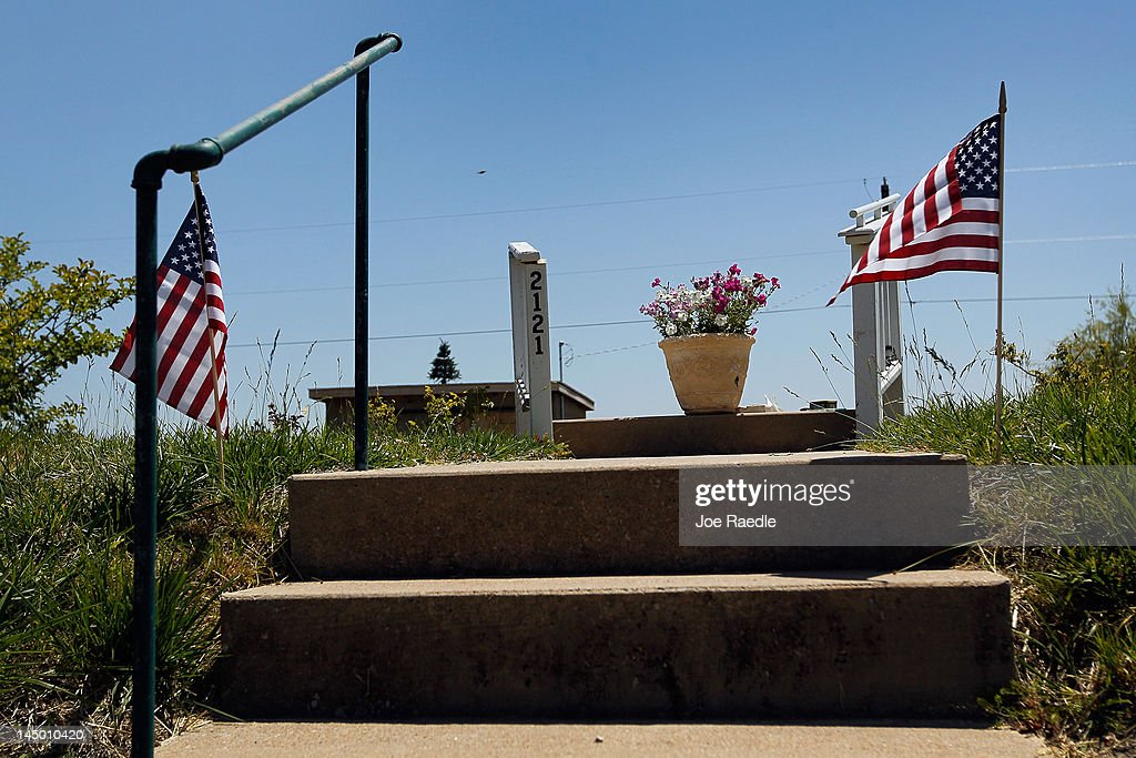 A flower pot and flowers are seen on what used to be the stairway leading to a home before it was destroyed one year ago today when the town was hit by a catastrophic tornado on May 22, 2012 in Joplin, Missouri. The EF-5 tornado hit the town leaving behind a path of destruction along with 161 deaths and hundreds of injuries, but one year later there are signs that the town is beginning to recover.
