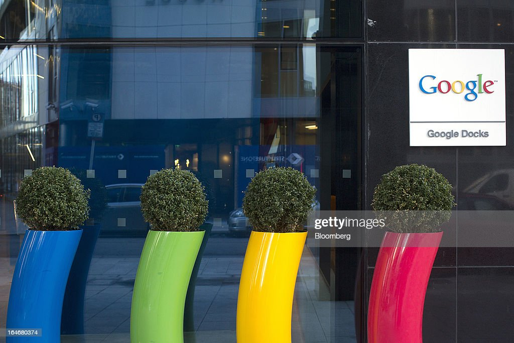 Flower pots in the corporate colors of Google Inc. are seen standing at the entrance to the company's European headquarters in Dublin, Ireland, on Friday, March 15, 2013. Ireland's renewed competiveness makes it a beacon for the U.S. companies such as EBay, Google Inc. and Facebook Inc., which have expanded their operations in the country over the past two years. Photographer: Simon Dawson/Bloomberg via Getty Images