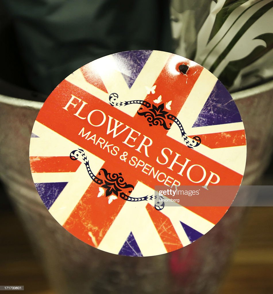 A 'Flower Shop' label with a British Union flag design is seen inside a Marks & Spencer Group Plc (M&S) food hall in the Westfield Stratford City retail complex in London, U.K., on Thursday, June 27, 2013. U.K. retail sales rose more than economists forecast in May as consumers spent more online and food sales increased at their fastest pace for more than two years. Photographer: Chris Ratcliffe/Bloomberg via Getty Images