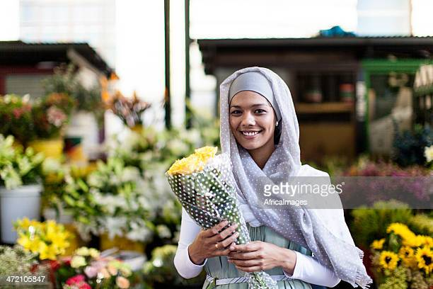 Flower shop owner holding her flowers in Cape Town