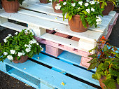Flower stand made of painted wooden pallets