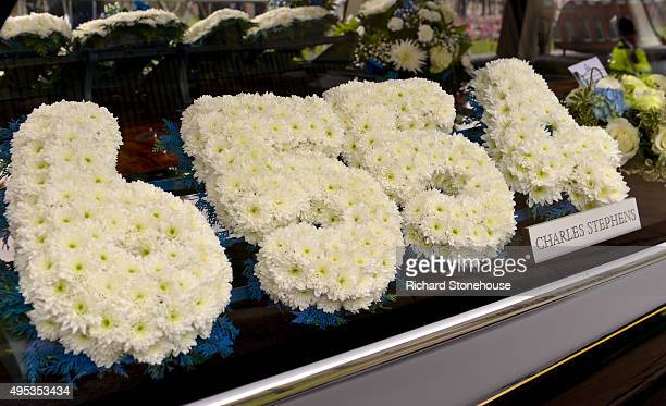 A flower tribute which spells out the numbers '6554' is displayed inside the hearse at the funeral of PC David Phillips at Liverpool Anglican...