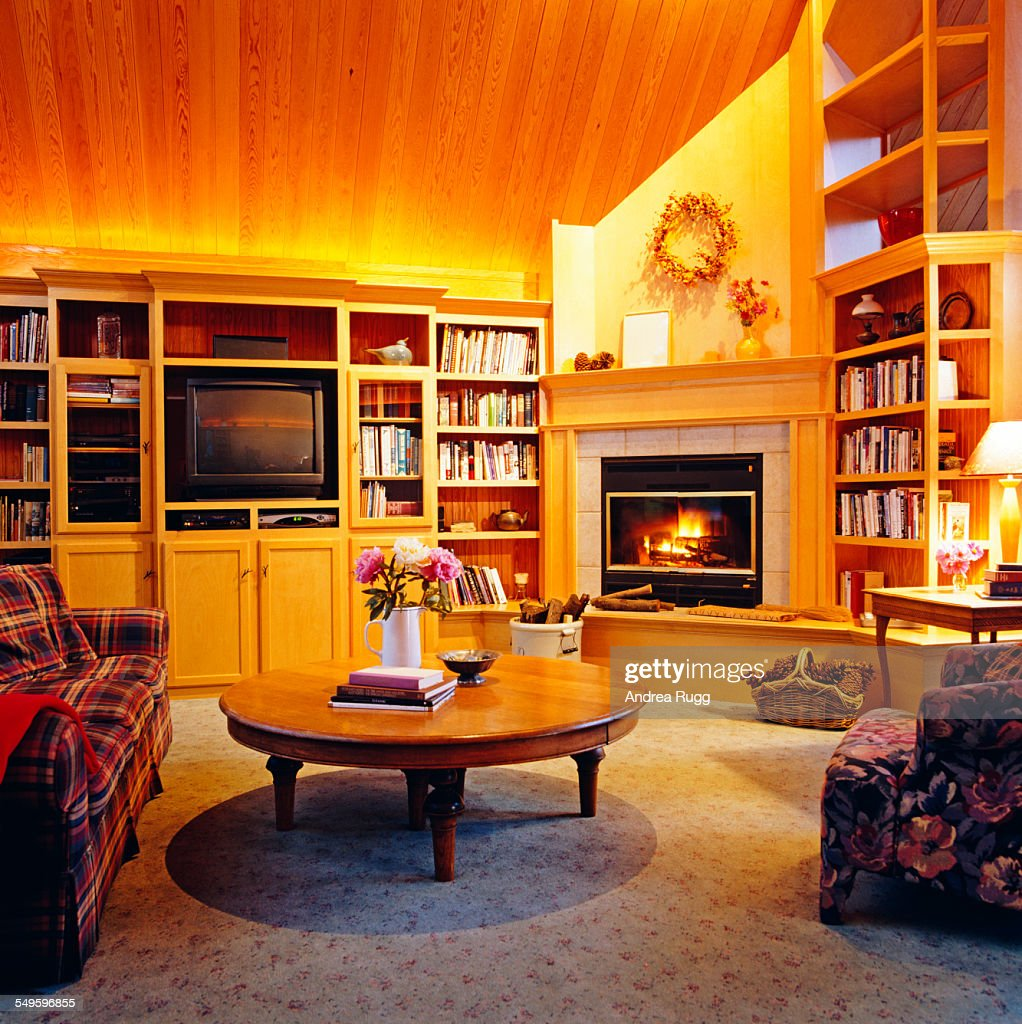 Flower Vase And Books Are Kept On The Center Table In Living Room Stock