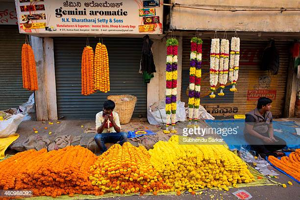 Flower vendors at a wholesale flower market in the old quarters of Bangalore