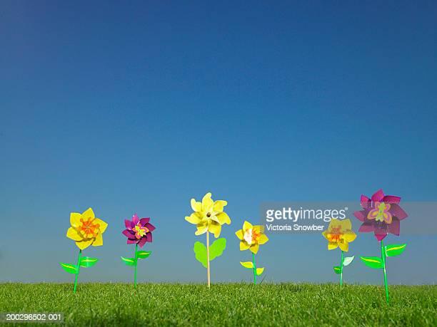Flower windmills in field