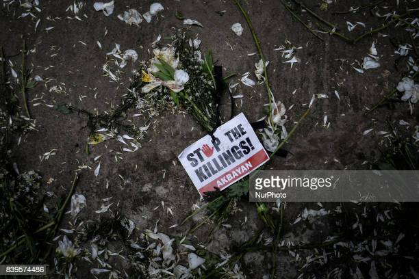 A flower with a slogan attached is seen on the ground following Kian Loyd Delos Santos funeral in Caloocan Metro Manila Philippines August 26 2017...
