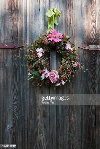 Flower wreath hanging on wooden door