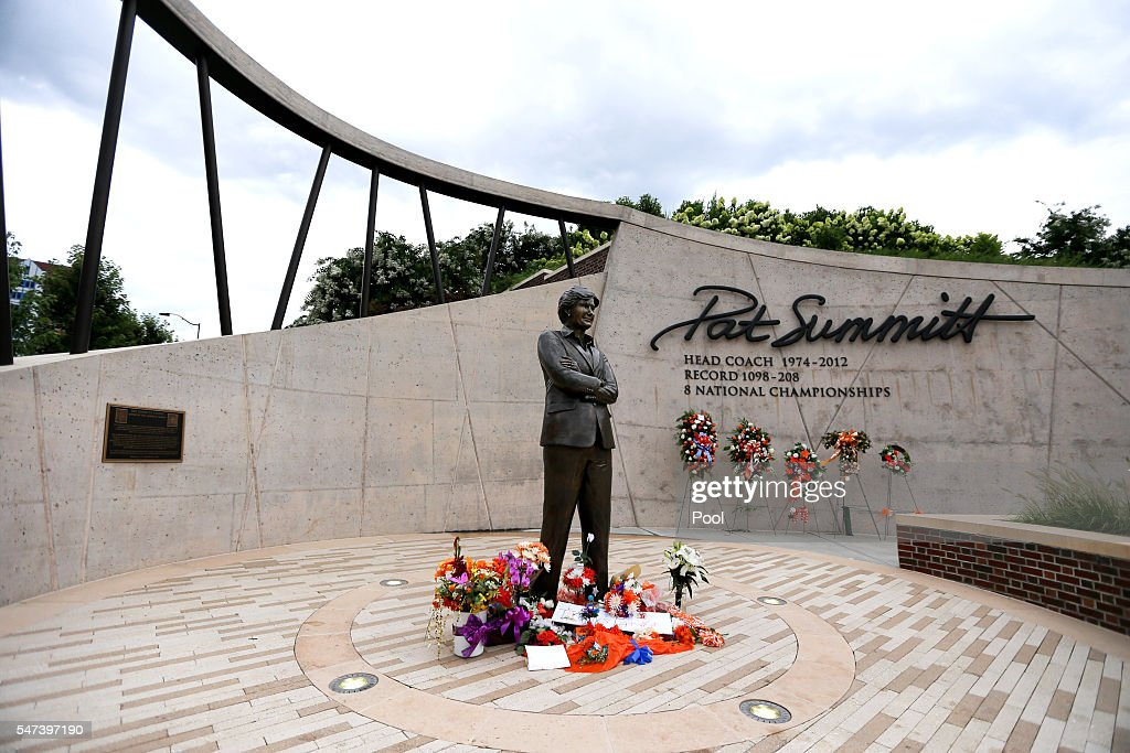 Flower wreaths line the wall at Pat Summitt Plaza before the start of a ceremony to celebrate the life of former Tennessee women's basketball coach...