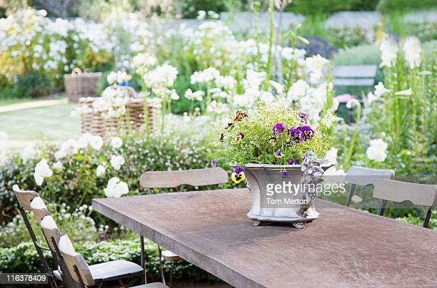 Flowerpot on garden table