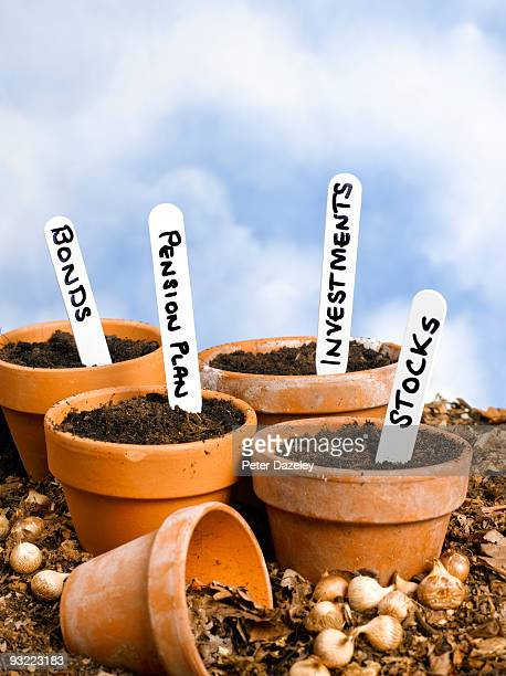 Flowerpots with investment labels.