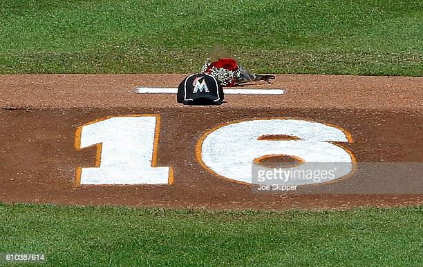 Flowers a hat and the number of Miami Marlins pitcher Jose Fernandez is shown on the pitching mound at Marlins Park on September 25 2016 in Miami...