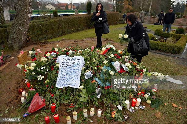 Flowers a Tshirt with sayings for and a picture of Tugce are placed at the grave of Tugce Albayrak the 23yearold university student who died after...