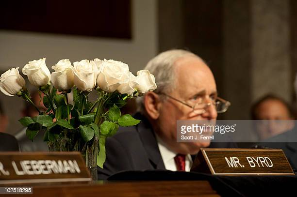 Flowers adorn Sen Robert C Byrd's place at the dais as Chairman Carl Levin DMich opens the Senate Armed Services hearing for US Army Gen David H...