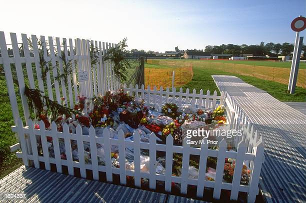 Flowers adorn the grave of Red Rum situated next to the finishing post at Aintree racecourse in Liverpool England Mandatory Credit Gary M...