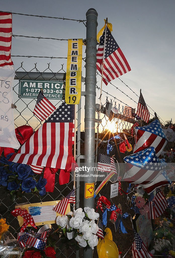 Flowers, American flags and mementos adorn the outside fence of Station 7 on July 3, 2013 in Prescott, Arizona. Nineteen firefighters based out of Station 7 died battling a fast-moving wildfire near Yarnell, Arizona on June 30. Station 7 has been the home of the Granite Mountain Interagency Hotshot Crew since 2010.