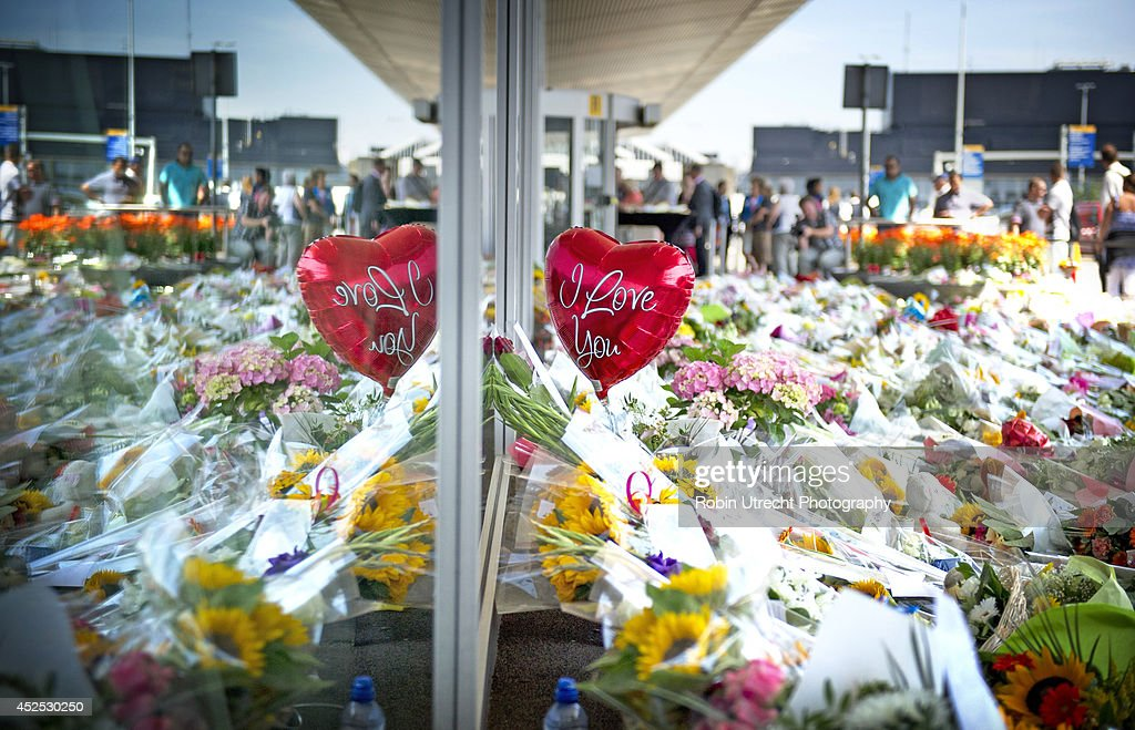 Flowers and a ballon are placed to commemorate the victims of Malaysian Airlines flight MH17 at Schiphol Airport on July 22, 2014 in Amsterdam, Netherlands. Flight MH17 was travelling from Amsterdam to Kuala Lumpur when it crashed killing all 298 on board including 80 children. The aircraft was allegedly shot down by a missile and investigations continue over the perpetrators of the attack.