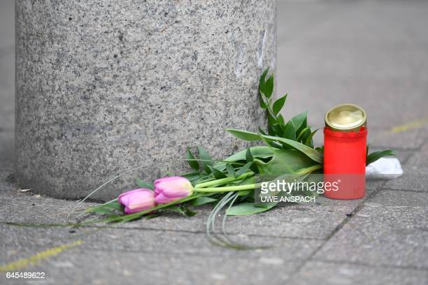Flowers and a candle are placed on February 26 2017 at the site where a man ploughed with a car into pedestrians the day before in Heidelberg western...
