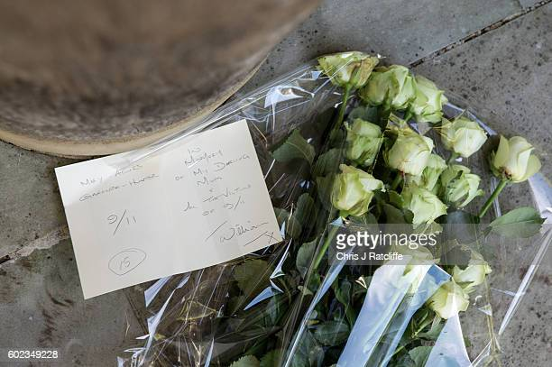 Flowers and a card are left by a daughter of a victim of the 9/11 terroism attacks at the September 11 Memorial Garden on September 11 2016 in London...