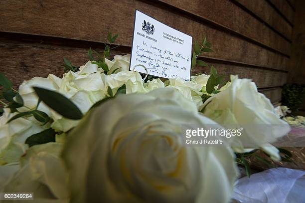 Flowers and a card are left by the British Prime Minister Theresa May to the victims of the 9/11 terroism attacks at the September 11 Memorial Garden...