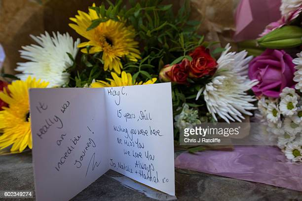 Flowers and a card are left members of the public to victims of the 9/11 terroism attacks at the September 11 Memorial Garden on September 11 2016 in...