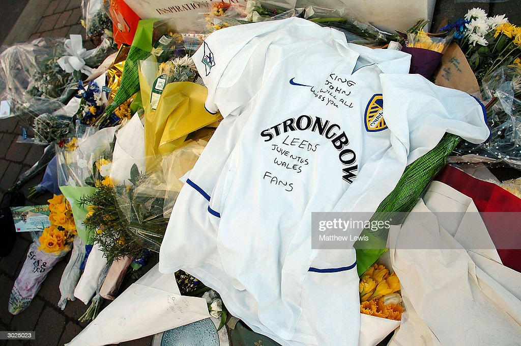 Flowers and a Leeds shirt are left by the Billy Bremner statue in memory of former player John Charles who died last week before the FA Barclaycard Premiership match between Leeds United and Liverpool at Elland Road on February 29, 2004 in Leeds, England.
