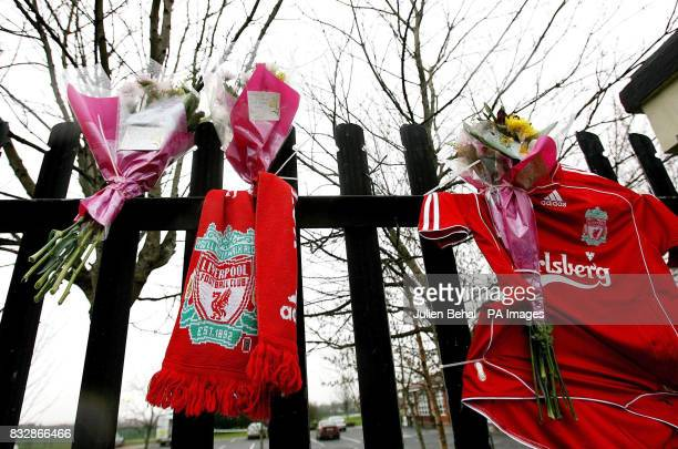 Flowers and a Liverpool football shirt and scarf are left at the football pitch at Dublin City Services Sports and Social Club in the west of the...