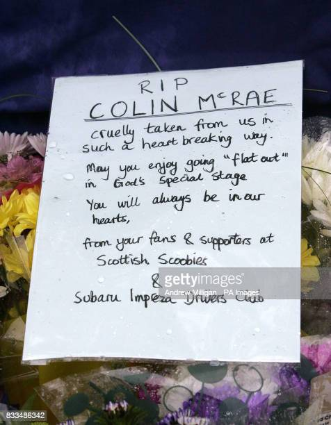 Flowers and a note left by the Scottish Subaru Imprezza owners club at the entrance to Colin Mcrae's house after he died in a helicopter crash in the...