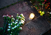 Flowers and a single candle are left at a makeshift memorial for Robin Williams on August 11 2014 in Boulder Colorado The exterior of the house was...