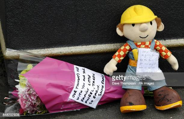Flowers and a soft toy left inside a cordon close to the scene of a suspected gas blast in Buckley Street in the Shaw area of Oldham Greater...