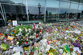 Flowers and candle tributes are left to commemorate the victims of Malaysian Airlines flight MH17 at Schiphol Amsterdam Airport on July 28 2014 near...