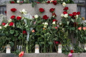 Flowers and candles are left after a memorial vigil following Friday's twin extremist attacks Anders Behring Breivik claimed that he has 'two more...