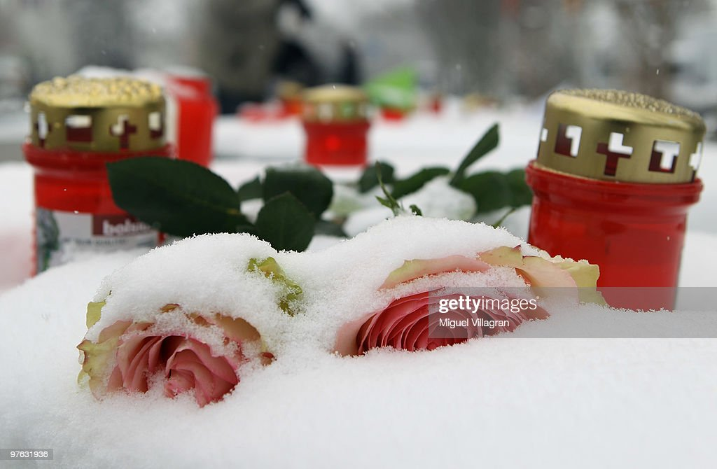 Flowers and candles are pictured close to the Albertville School on March 11, 2010 in Winnenden, Germany. Tim Kretschmer opened fire on teachers and pupils at his former school a year ago on March 11, 2009, killing 15 and leaving many more injured. Kretschmer fled the scene and shot himself dead after being cornered by police.