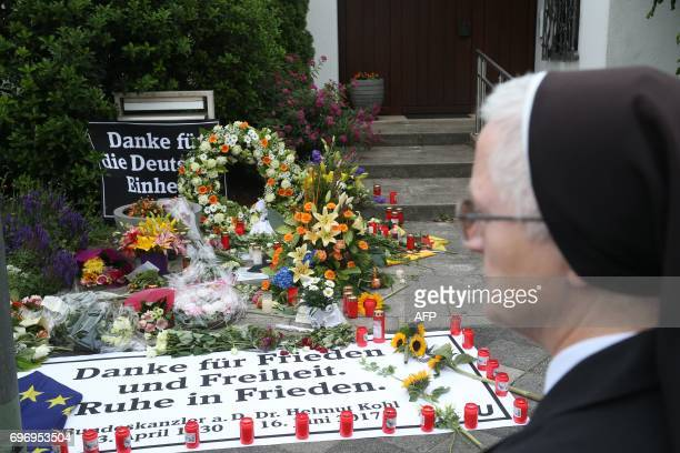 Flowers and candles are placed in front of the house of former German Chancellor Helmut Kohl in Oggersheim near Ludwigshafen western Germany on June...