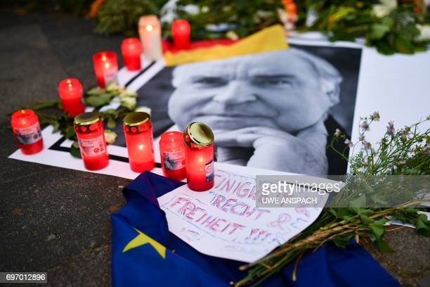 Flowers and candles are placed with a photo of former German Chancellor Helmut Kohl in front of his house in Oggersheim near Ludwigshafen western...
