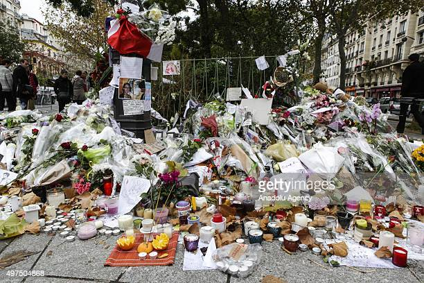 Flowers and candles are seen at the memorial for the victims of Paris terror attacks in front of Bataclan Boulevard Voltaire in Paris France on...