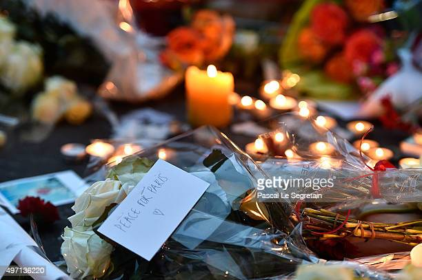 Flowers and candles are seen near the Bataclan concert hall on November 14 2015 near the scene of the Bataclan Theatre terrorist attack on November...