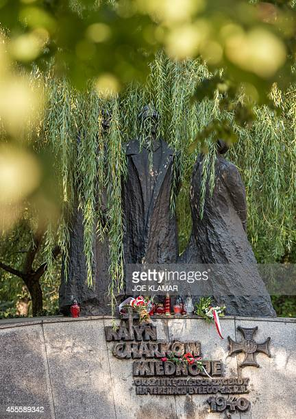 Flowers and candles decorate a memorial dedicated to the victims of communism to mark the 75th anniversary of the Soviet invasion of Poland at the...