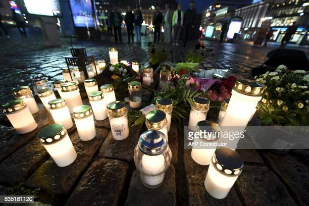 Flowers and candles have been left at the Turku Market Square in the Finnish city of Turku where several people were stabbed on August 18 2017 One...